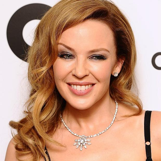 Kylie Minogue is backing Jason Donovan in Strictly Come Dancing