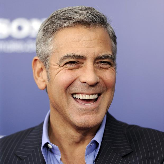 George Clooney attends the premiere of Ides Of March at the Ziegfeld Theatre in New York