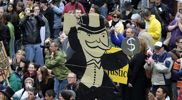 The Occupy Wall Street movement is expressing dissatisfaction at corporate greed (AP)