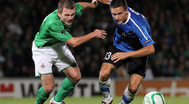 ©Press Eye Ltd Northern Ireland- 07th October 2011 Mandatory Credit - Photo-William Cherry/PresseyeEuro 2012 qualifier - Northern Ireland v EstoniaNorthern Ireland's Lee Hodson with Estonia's Martin Vunk during Friday nights Euro 2012 qualifier against Estonia at Windsor Park.