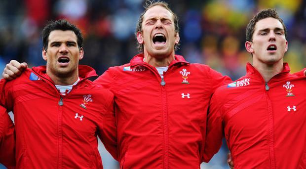 WELLINGTON, NEW ZEALAND - OCTOBER 08: (L-R) Mike Phillips, Alun Wyn Jones and George North sing their national anthem ahead of the quarter final one of the 2011 IRB Rugby World Cup between Ireland v Wales at Wellington Regional Stadium on October 8, 2011 in Wellington, New Zealand. (Photo by Stu Forster/Getty Images)