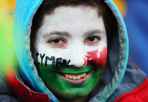 WELLINGTON, NEW ZEALAND - OCTOBER 08: A Wales fan enjoys the atmosphere prior to the quarter final one of the 2011 IRB Rugby World Cup between Ireland v Wales at Wellington Regional Stadium on October 8, 2011 in Wellington, New Zealand. (Photo by Mike Hewitt/Getty Images)