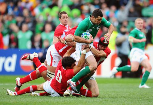WELLINGTON, NEW ZEALAND - OCTOBER 08: Rob Kearney of Ireland is tackled by Mike Phillips, Leigh Halfpenny and Toby Faletau of Wales during quarter final one of the 2011 IRB Rugby World Cup between Ireland v Wales at Wellington Regional Stadium on October 8, 2011 in Wellington, New Zealand. (Photo by Stu Forster/Getty Images)