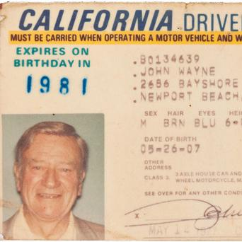 Issued in 1977, two years before he died, John Wayne's California driver's licence sold for almost 60,000 pounds (AP)