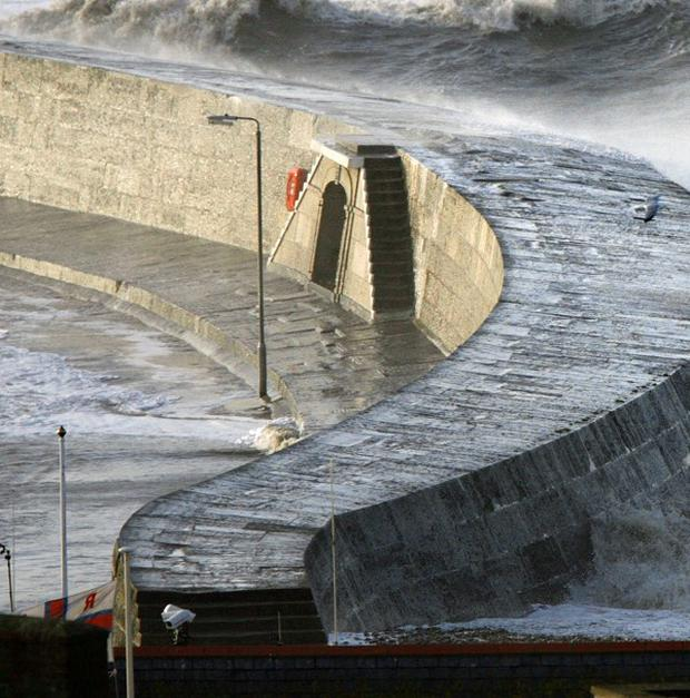 A woman in a wheelchair has died after falling into deep harbour water from the historic Cobb in Lyme Regis