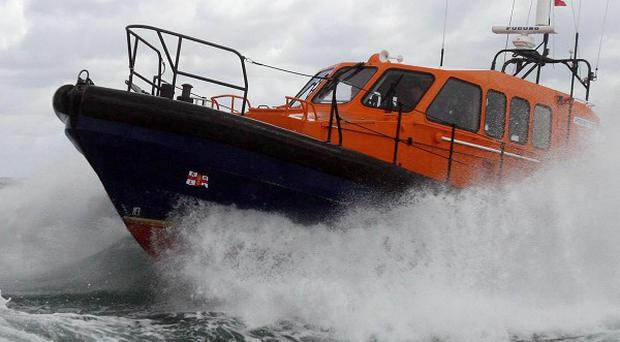 Two fishermen have been rescued from the water off the Cumbria coast by an RNLI lifeboat after their boat sank