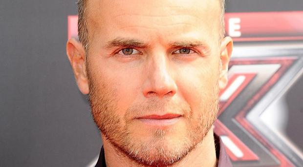 Take That star Gary Barlow has revealed he endured a battle with depression when the band split