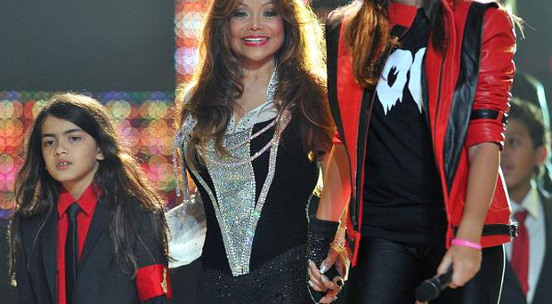 Michael Jackson's sister Latoya Jackson with his children Blanket (left) and Paris at the Michael Forever Tribute Concert