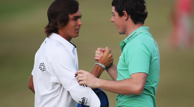 Rory McIlroy (right) congratulates his good friend Ricky Fowler