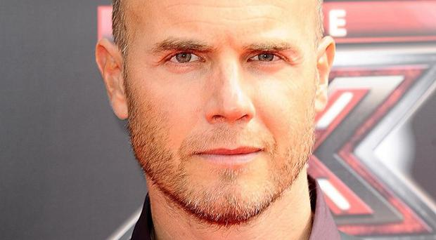 Gary Barlow suffered depressed when Take That first split up, he has revealed
