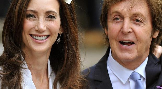 Sir Paul McCartney and Nancy Shevell leave Marylebone Registry Office in north London after getting married
