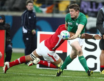 WELLINGTON, NEW ZEALAND - OCTOBER 08: Brian O'Driscoll of Ireland off loads as he tackled by Toby Faletau of Wales during the IRB RWC Quarter Final match between Ireland and Wales at Wellington Regional Stadium on October 08, 2011 in Wellington, New Zealand. (Photo by Steve Haag/Gallo Images/Getty Images)