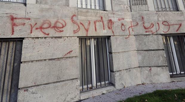 Protesters have stormed the Syrian embassy in Berlin and left graffiti on the outside walls (AP)