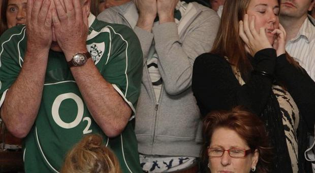 Ireland fans in the Kielys of Donnybrook pub, Dublin, despair as the team is beaten 22-10 by Wales in the rugby world cup