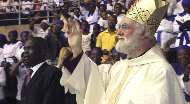 The Archbishop of Canterbury Rowan Williams greets worshippers to a religious service in Harare, Zimbabwe (AP)
