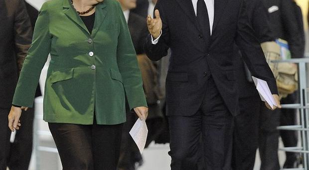 German chancellor Angela Merkel and French President Nicolas Sarkozy have reached an agreement over Europe's banks (AP)
