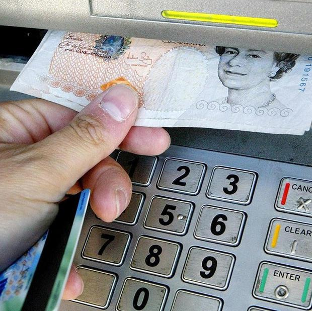 MPs have questioned restrictions on free cash machine withdrawals for customers of two banks