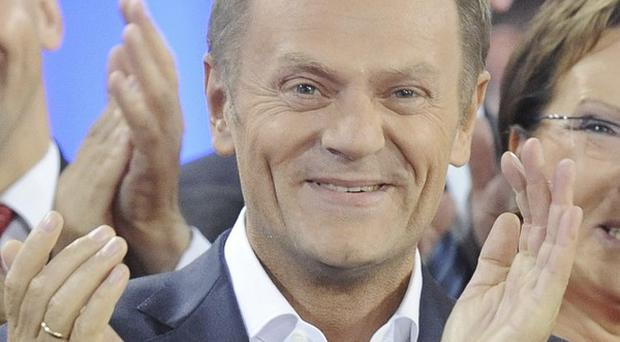 Polish prime minister Donald Tusk appears to have clinched a second term in office (AP)
