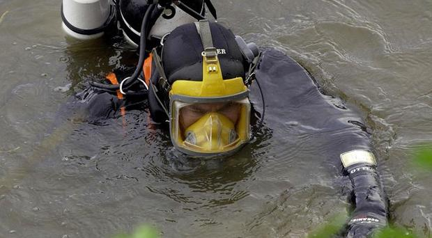 Navy divers have recovered the body of a man last seen fishing with a friend