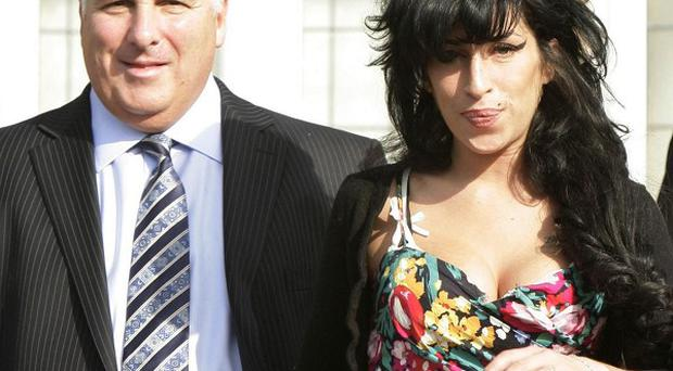 Amy Winehouse's father Mitch is to write a book about her