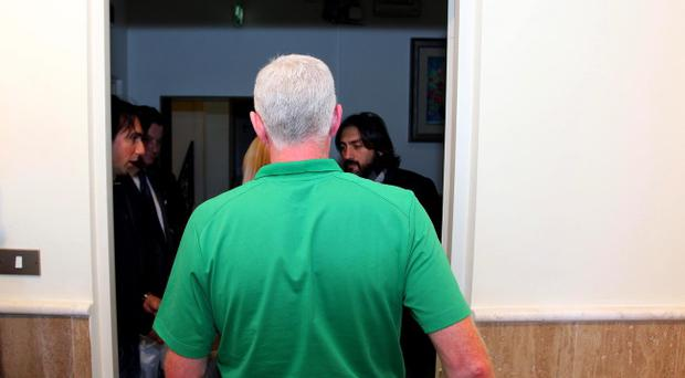 Walking away: Nigel Worthington leaves the press conference after announcing his resignation as Northern Ireland manager