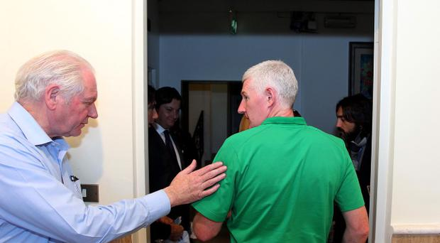 IFA President Jim Shaw (left) pats Nigel Worthington on the back as he leaves Monday's press conference where he resigned as Northern Ireland manager