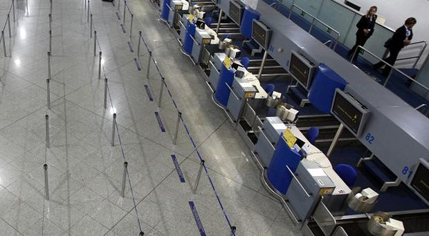 Empty check-in counters at Eleftherios Venizelos airport during a strike in Athens