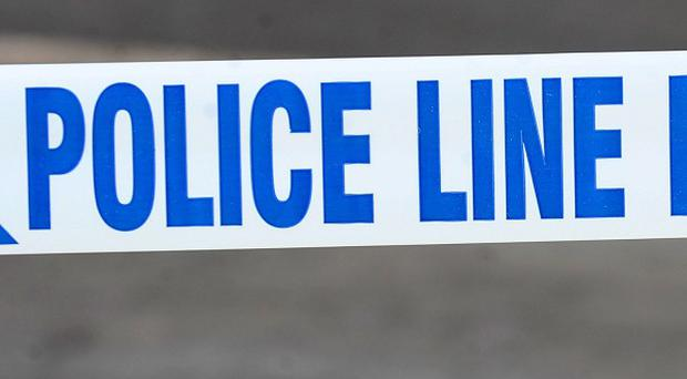 Police in Strabane are hunting masked men who hijacked a taxi armed with a gun