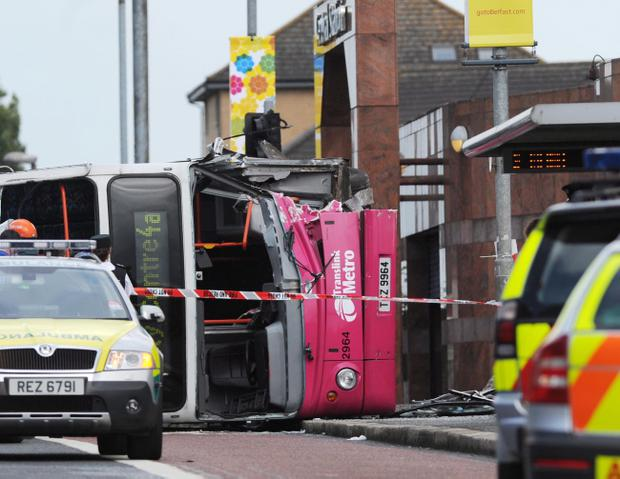 The overturned doubledecker bus outside Belfast's Central Station