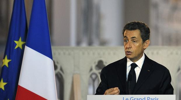 Strikes are taking place in France over cost-cutting measures which president Nicolas Sarkozy said are essential to reduce debts (AP)