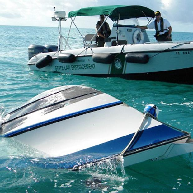 A capsized boat in the waters off the Florida Keys (AP)