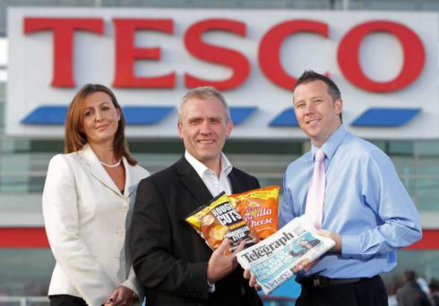 Marette Mooney from the Belfast Telegraph; Paul Moore from Tayto and Steven Murphy from Tescos launch the latest Belfast Telegraph Reader Promotion at Tesco. Readers who purchase their Belfast Telegraph in any Tesco main or express store between Wednesday 12th and Friday 14th October will receive a free family sized packet of Tayto crisps worth £1.79. Readers can choose from two flavours Chargrilled Rough Cuts and Tortilla cheese.