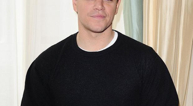 Matt Damon says his wife helps him deal with his showbiz life