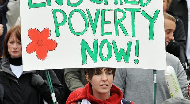 Almost a quarter of Britain's children could be left in poverty from Government policies, a report suggests