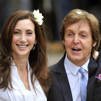 Sir Paul McCartney and his new wife are in no rush for a honeymoon
