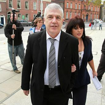 Liam Adams, brother of Sinn Fein president Gerry Adams, was supported in court by daughter Claire Smith