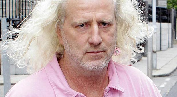 TD and developer Mick Wallace leaves the Commercial Court in Dublin, after he was ordered to repay the more than 19m euro he owes to ACC Bank