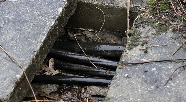 A cable shaft where three separate explosive devices were found by the side of a Berlin rail track(AP)
