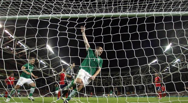Republic of Ireland's Richard Dunne celebrates scoring his side's second goal