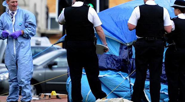 Police at the scene in Bexleyheath, south-east London, where a woman was stabbed to death and another was injured
