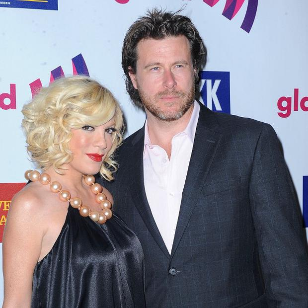 Actress Tori Spelling and husband Dean McDermott are celebrating the birth of their third child