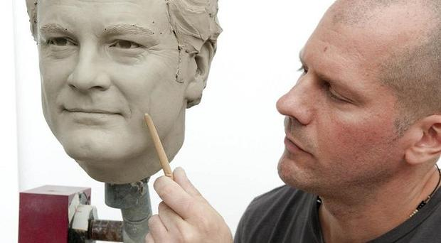 Sculptor Louis Wiltshire working on the head of Madame Tussauds' wax figure of Colin Firth