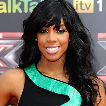 Kelly Rowland says she's tempted to cut her hair off