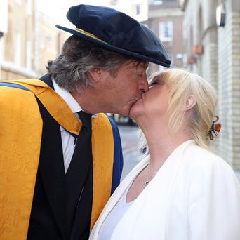 Richard Madeley and his wife Judy kiss after he received an honorary degree