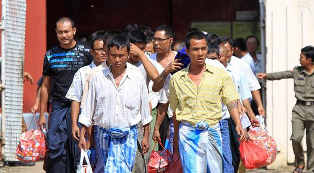 Prisoners walk out of Insein Prison in Yangon, Burma (AP)