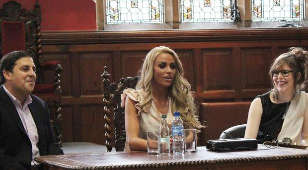Katie Price, centre, addresses students in the Oxford Union (Oxford Union/PA Wire)