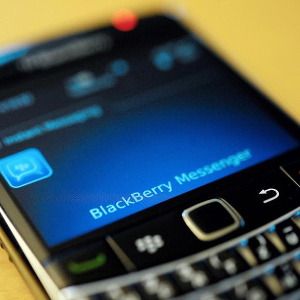 Problems with BlackBerry phones have entered a third day, with users in America and Canada now also affected (AP)