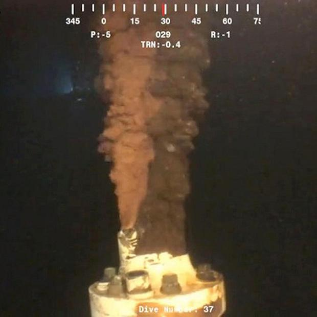 Oil pours from a broken well following the Deepwater Horizon rig explosion (AP)