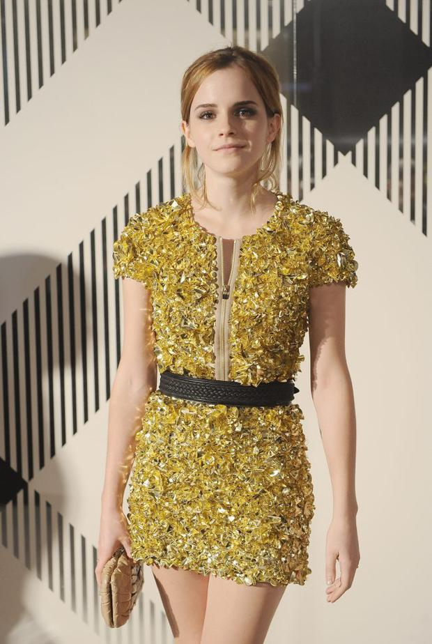 Harry Potter star Emma Watson dressed in Burberry at 2010 London Fashion Week