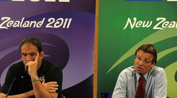 England coach Martin Johnson and RFU operations director Rob Andrew (right) face the media after England's exit